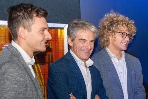 Angelo Tondini al centro con i figli Marco e Giorgio