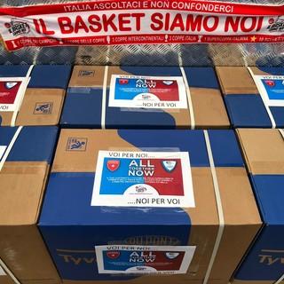 Primo canestro della solidarietà targato Varese e Cantù: 600 tute donate all'Ospedale di Circolo
