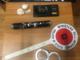 Cocaina e un silenziatore nascosti in casa: denunciato dalla polizia